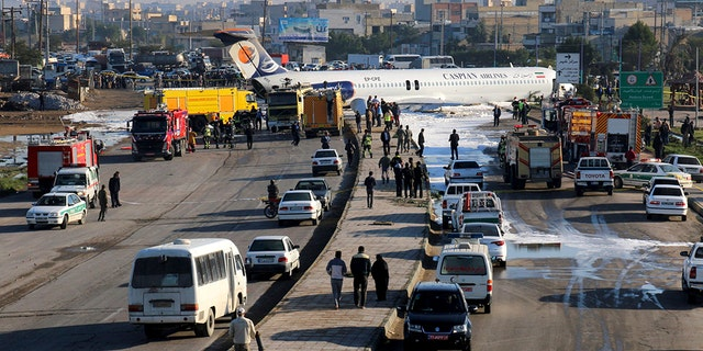 Iran Airliner with 135 passengers overshoots runway, barrels into highway; no casualties