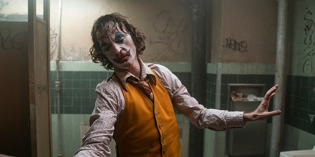 "This image released by Warner Bros. Pictures shows Joaquin Phoenix in a scene from ""Joker."" On Monday, Jan. 13, the film was nominated for an Oscar for best picture."