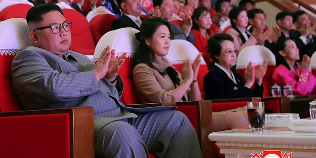 In this Saturday, Jan. 25, 2020, photo provided by the North Korean government, North Korean leader Kim Jong Un, center, claps with his wife Ri Sol Ju, third from right, and his aunt Kim Kyong Hui, second from right, as they attend a concert celebrating Lunar New Year's Day in Pyongyang, North Korea. (AP/Korean Central News Agency/Korea News Service)