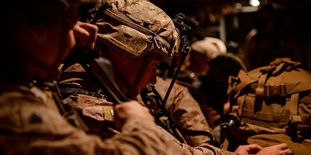 In this photo provided by U.S. Department of Defense, U.S. Marines prepare to deploy from Kuwait on Dec. 31. (AP/U.S. Marine Corps/Sgt. Robert G. Gavaldon)
