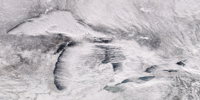 "Parallel rows of clouds, known as ""cloud streets"" can be seen streaming over the Great Lakes on Christmas Day 2017 when up to 60 inches of snow fell on parts of Pennsylvania."