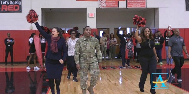 U.S. Army Spc. Shakir Aquil recently surprised his mom at the school where she works in Atlanta.