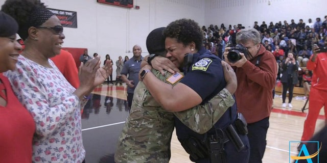In a heartwarming video that has since gone viral, Aquil jogged out from behind the basketball players and cheerleaders in his fatigues, to embrace his emotional mom with a bear hug.