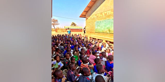 Children at theChipala Primary School in Lilongwe, Malawi, frequently would learnlessons outdoors, seated shoulder-to-shoulder on loose, red dirt.