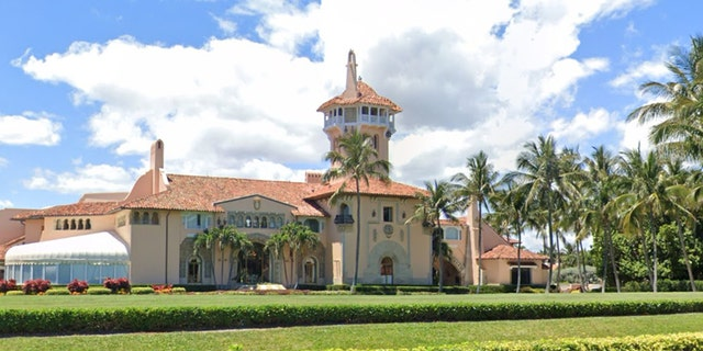 Two people have been arrested Friday after breaching security checkpoints at the Mar-a-Lago Club in Palm Beach, Fla.