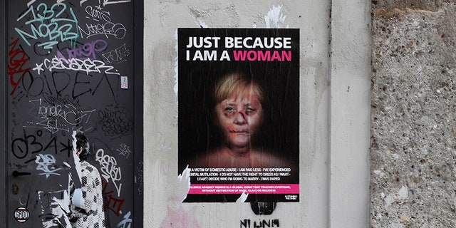 A poster shows a manipulated picture of German Chancellor Angela Merkel. (AP)