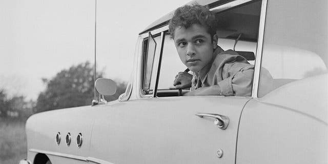 An early snapshot of Sal Mineo at home in The Bronx, New York.
