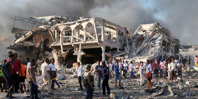 Somalis gather and search for survivors following a deadly truck bombing in Mogadishu, in October 2017. (AP)