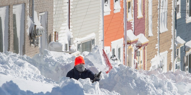 A resident digs out his walkway in St. John's Newfoundland on Saturday, Jan. 18, 2020. Andrew Vaughan/The Canadian Press via AP)
