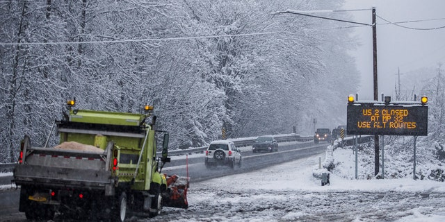 A snow plow waits at the side of a road in Monroe, Wash., Monday, Jan. 13, 2020.