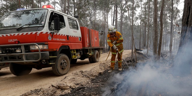 Authorities are using relatively benign conditions forecast in southeast Australia for a week or more to consolidate containment lines around scores of fires that are likely to burn for weeks without heavy rainfall. (AP Photo/Rick Rycroft)