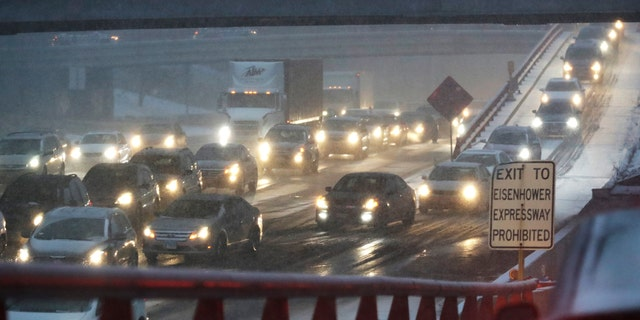Heavy traffic is seen on Eisenhower Expressway in Chicago, Friday, Jan. 17, 2020. Hundreds of flights were canceled as a winter storm hits the city during evening commute Friday, creating a sloppy rush hour. (AP Photo/Nam Y. Huh)