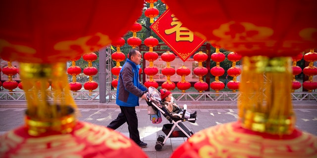 China's most festive holiday began in the shadow of a worrying new virus Saturday as the death toll grew, an unprecedented lockdown kept 36 million people from traveling and authorities canceled a host of Lunar New Year events.