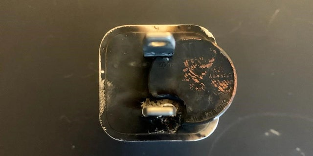 "A penny and a phone-charger plug are fused together after a recent ""outlet challenge"" incident. (Plymouth Fire Department)"