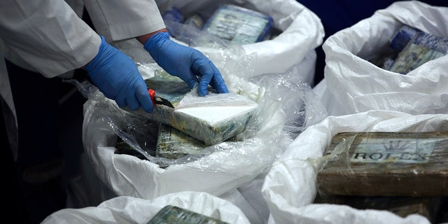 A large supply of recently seized cocaine was displayed to the press at the Portuguese police headquarters in Lisbon on Wednesday. (AP Photo/Armando Franca)