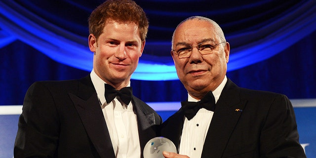Prince Harry receives the Distinguished Humanitarian Leadership Award presented by former Secretary of State Colin Powell during the Atlantic Council 2012 Annual Awards Dinner at a hotel in Washington, DC, on May 7, 2012. Prince Harry joined a black-tie dinner in Washington to accept a humanitarian prize for his work supporting charities that help injured British and U.S. military personnel.