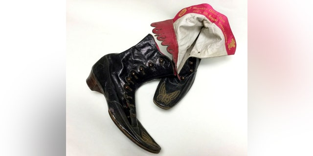 Queen Victoria clothing that is coming up for auction - ankle boots. The items include cream and red stockings, a chemise, black skirt, bodice, bloomers and two pairs of handmade leather ankle boots by J Sparks-Hall of London – a shoemaker credited with the design of the Chelsea boot. (Credit: SWNS)