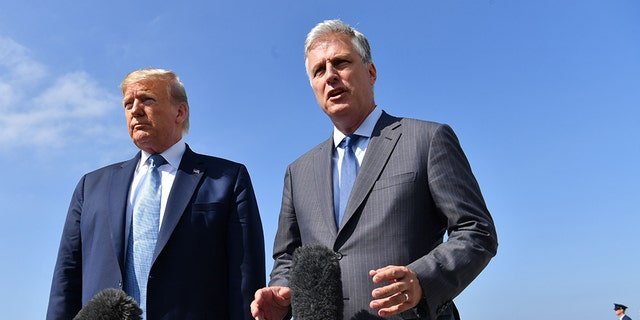 US President Donald Trump(L)speaks next to new national security advisor Robert O'Brien on September 18, 2019 at Los Angeles International Airport in Los Angeles, California. (Photo by Nicholas Kamm / AFP via Getty Images)