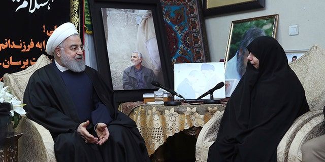 Iranian President Hassan Rouhani, left, meets family of Iranian Revolutionary Guard Gen. Qassem Soleimani, who was killed in the U.S. airstrike in Iraq, at his home in Tehran, Iran, on Saturday.
