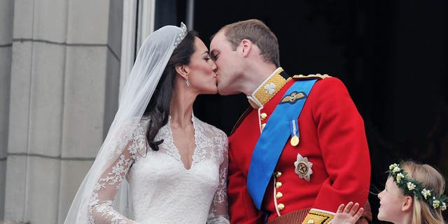 Kate Middleton and Prince William share a kiss on their wedding day at Westminster Abbey on April 29, 2011.