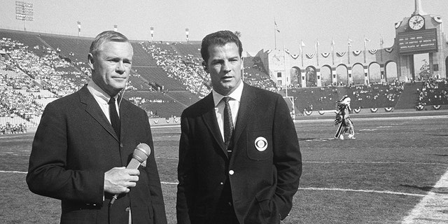 Sports commentators Paul Christman, for NBC, and Frank Gifford, for CBS, on Jan. 15, 1967. (Photo by CBS via Getty Images)