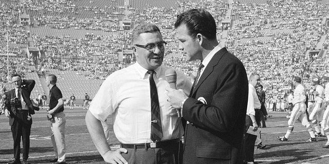 Vince Lombardi speaks to CBS Sports commentator Frank Gifford during the first Super Bowl on Jan. 15, 1967. (Photo by CBS via Getty Images)