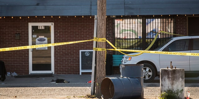 Crime scene tape stretches in front of Mac's Lounge, the scene of an early morning bar shooting on Sunday. (AP Photo/Sean Rayford)