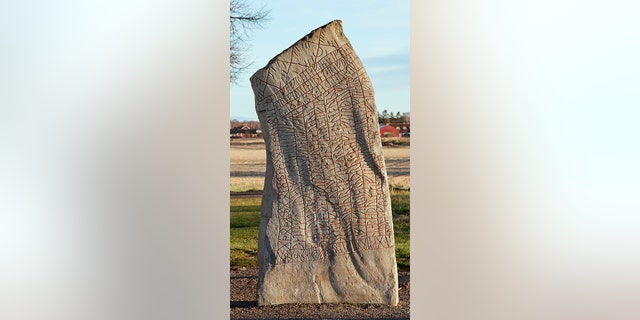 Stone covered in runes from the 9th century. (Credit: iStock)