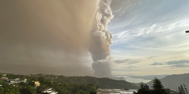 Plumes of smoke and ash rise from as Taal Volcano erupts Sunday Jan. 12, 2020, in Tagaytay, Cavite province, outside Manila, Philippines.