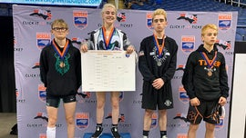 Female wrestler makes history, wins state high school championship