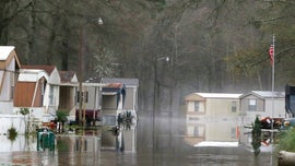 Flood-soaked Mississippi braces for additional rain as Alabama declares emergency