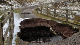 Storms cause massive hole to open up in bridge at national park in the UK