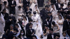 Thousands of couples tie knot in mass wedding amid coronavirus fears