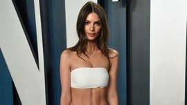 Emily Ratajkowski poses nude behind sheer curtain during her coronavirus quarantine