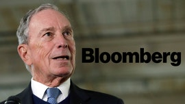 Bloomberg News ex-reporter's wife says his lawyers threatened to 'ruin' family over China reporting