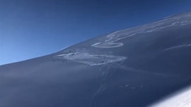 Avalanche in Colorado partially buries snowmobiler in 'terrifying' video