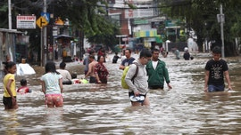 Thousands caught in floods in Indonesia's sinking capital