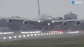 Etihad Airways pilot performs crosswind landing at Heathrow Airport due to strong winds