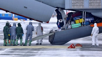 Russian woman who escaped hospital coronavirus quarantine locks herself in home, report says