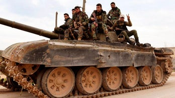 Israel strikes Iran-backed fighters in Syria, killing more than 20, monitoring group says