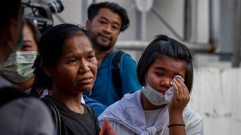Thailand shooting spree victims' families in anguish, awaiting bodies after 29 killed
