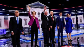 Bloomberg under siege at chaotic debate debut, as Warren attacks field in bid to revive campaign