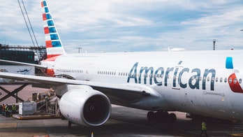 American Airlines passenger wearing gas mask is removed from Texas flight