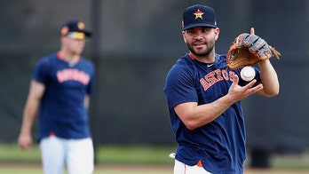 Houston Astros players heckled by fans during batting practice at spring training