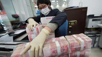 Coronavirus triggers China to destroy, quarantine cash in outbreak hotspots, reports say