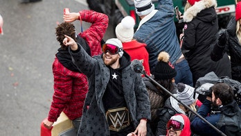 Kansas City Chiefs' Travis Kelce, in WWE belt, gives intense victory speech