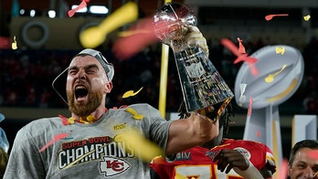 Kansas City Chiefs' Travis Kelce chugs beer off Lombardi Trophy, calls it 'Lombardi Luge'