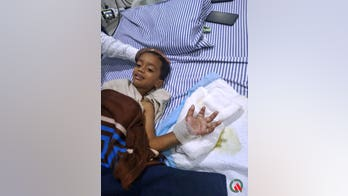 Doctor reattaches boy's hand severed during horror lawnmower incident