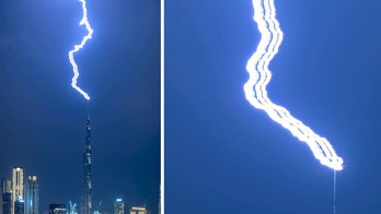 Photographer captures remarkable image of lightning striking world's tallest building — three times in a row