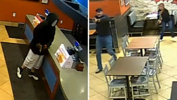 Married Kentucky police officers cut date night short at fried chicken restaurant to thwart armed robbery